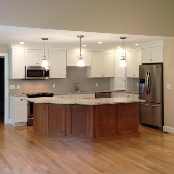 white kitchen with dark wood island