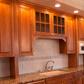 wood cabinets with tile backsplash